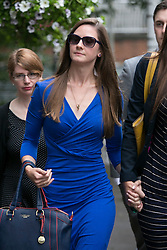 "© Licensed to London News Pictures. 14_07_2015. Solihull, West Midlands, UK. Pictured, BRYHER DUNSBY, widow of Cpl James Dunsby (blue dress, sunglasses). The inquest into the deaths of three army reservists taking place at Solihull Council House. Edward Maher, Craig Roberts and James Dunsby died after collapsing during an SAS training exercise on the Brecon Beacons in July 2013. The soldiers, from Hampshire, North Wales and Wiltshire, all suffered heatstroke during the 16-mile ""test week"" march. Photo credit : Dave Warren/LNP"