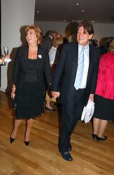 JOHN MADEJSKI and tv presenter CILLA BLACK at a party to celebrate the publication of Glass Houses by Sandra Howard held at Tamesa, Oxo Tower Wharf, Barge House Street, London SE1 on 5th September 2006.<br /><br />NON EXCLUSIVE - WORLD RIGHTS