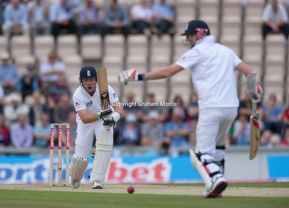 Ian Bell drives back past James Anderson (right) during the third npower Test Match between England and Sri Lanka at the Rose Bowl, Southampton.  Photo: Graham Morris (Tel: +44(0)20 8969 4192 Email: sales@cricketpix.com) 19/06/11