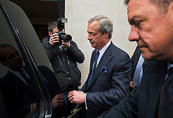 © Licensed to London News Pictures. 15/05/2015.  NIGEL FARAGE leaving UKIP party headquarters in Mayfair, London on May 15, 2015. Farage has been critiqued by members of the UKIP party after a u-turn on his decision to stand down as leader. Photo credit: Ben Cawthra/LNP
