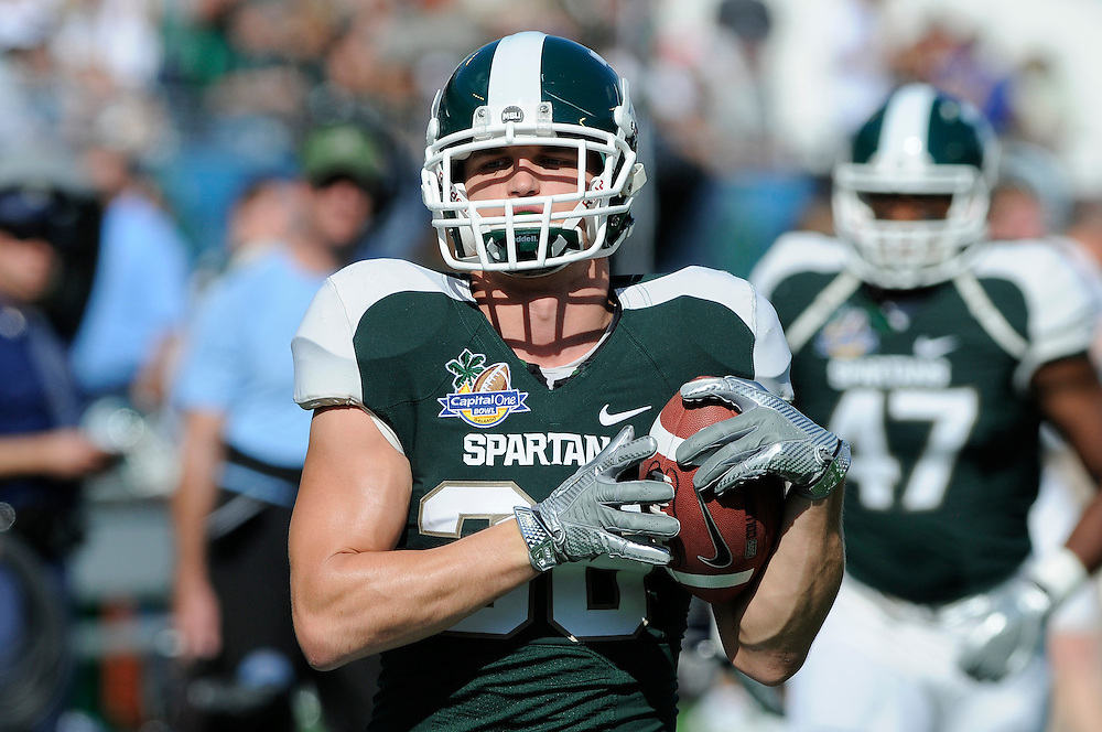 January 1, 2011: Jon Misch of the Michigan State Spartans in action during the NCAA football game between MSU and the Alabama Crimson Tide at the 2011 Capital One Bowl in Orlando, Florida. Alabama defeated Michigan State 49-7.