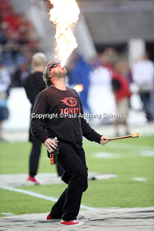 Members of the San Francisco 49ers Ignite team do a fire breathing performance before the San Francisco 49ers 2015 NFL week 1 regular season football game against the Minnesota Vikings on Monday, Sept. 14, 2015 in Santa Clara, Calif. The 49ers won the game 20-3. (©Paul Anthony Spinelli)