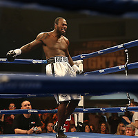 "Nat Heaven (silver shorts) celebrates his TKO against Donovan Dennis during the ESPN ""Boxcino"" boxing tournament at Turning Stone Resort Casino on Friday, April 18, 2014 in Verona, New York.  (AP Photo/Alex Menendez)"