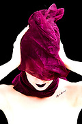 Tight face portraits of woman in purple cloth