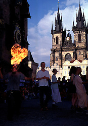 CZECH REPUBLIC BOHEMIA PRAGUE JUL97 -  A fire-eater shows his talents in front of the Tyn Cathedral in Prague's Old Town Square. ..jre/Photo by Jiri Rezac. . © Jiri Rezac 1997. . Tel:   +44 (0) 7050 110 417. Email: jiri@jirirezac.com. Web:   www.jirirezac.com