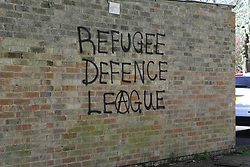"""© Licensed to London News Pictures. 03/04/2017. Croydon, UK. Graffiti on a wall reading """"REFUGEE DEFENCE LEAGUE"""" near the scene of a racial attack on a teenage asylum seeker by a gang of youths. Ten people have arrested, five charged and three remain in custody in relation with the incident which took place late on Friday evening.  Photo credit: Presspics/LNP"""