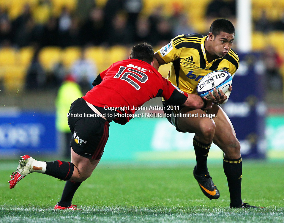 Hurricanes Julian Savea on the attack .Super15 rugby union match - Crusaders v Hurricanes at Westpac Stadium, Wellington, New Zealand on Saturday, 18 June 2011. Photo: Justin Arthur / photosport.co.nz