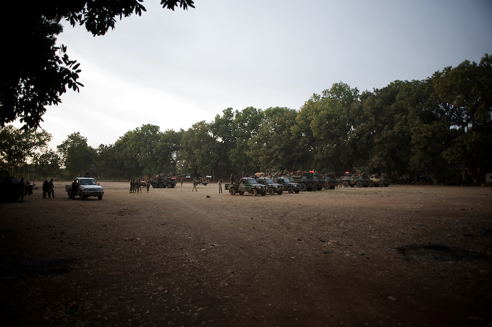 January 19, 2013 - Niono, Mali: French Army men gather in Niono's main square near the Mali police headquarters. Niono is the last government controlled location before Diabaly, a city under islamist militants control since the 14th of January.<br /> <br /> Several insurgent groups have been fighting a campaign against the Malian government for independence or greater autonomy for northern Mali, an area known as Azawad. The National Movement for the Liberation of Azawad (MNLA), an organisation fighting to make Azawad an independent homeland for the Tuareg people, had taken control of the region by April 2012.<br /> <br /> The Malian government pledge to the French army to help the national troops to stop the rebellion advance towards the capital Bamako. The french troops started aerial attacks on rebel positions in the centre of the country and deployed several hundred special forces men to counter attack the advance on the ground. (Paulo Nunes dos Santos/Polaris)