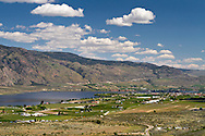 View of farmland, the town of Osooyos and Osoyoos Lake near Osoyoos, British Columbia, Canada