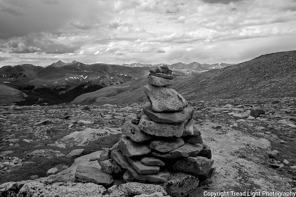 A cairn marks the convergence of four trails in the high valley north of Mt. Evans summit.