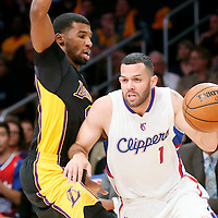31 October 2014: Los Angeles Clippers guard Jordan Farmar (1) drives past Los Angeles Lakers guard Ronnie Price (9) during the Los Angeles Clippers 118-111 victory over the Los Angeles Lakers, at the Staples Center, Los Angeles, California, USA.