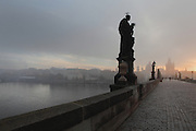 Dawn at the Charles Bridge or Karluv most, built 1357 - 15th century, looking towards the Old Town bridge tower and with the Vltava river to the left, Prague, Czech Republic. Its construction began under King Charles IV, replacing the old Judith Bridge built 1158'??1172 after flood damage in 1342. This new bridge was originally called the Stone Bridge (Kamenny most) or the Prague Bridge (Prazsky most) but has been the Charles Bridge since 1870. The bridge is 621m long and nearly 10m wide, resting on 16 arches shielded by ice guards. It is protected by three bridge towers, two on the Lesser Quarter side and one on the Old Town side. The historic centre of Prague was declared a UNESCO World Heritage Site in 1992. Picture by Manuel Cohen