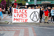 Counter-protesters display a Black Lives Matter sign at the Freedom Rally at Westlake Park. Seattle, WA. August 13, 2017.