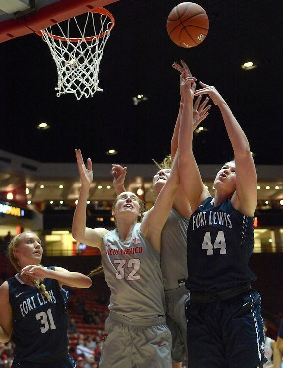 gbs110101i/SPORTS --  Ft. Lewis' Alyssa Yocky, 31, and Ande Lampert, 44, battle UNM's Kianna Keller, 32, and Ridhelle van der Keijl for a rebound during the game in the Wise Pies Arena aka The Pit on Tuesday, November 1, 2016.(Greg Sorber/Albuquerque Journal)