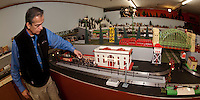 Tom Smith starts up a 1927 #262 Steamer at the Laconia Antiques Center upper level where they have set up a model train extravaganza  open to the public year round.  (Karen Bobotas/for the Laconia Daily Sun)