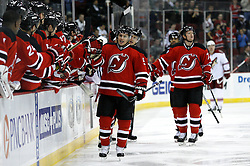 Mar 12, 2009; Newark, NJ, USA; New Jersey Devils left wing Zach Parise (9) gets congratulations from his teammates after his goal during the first period at the Prudential Center.