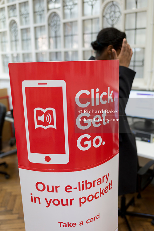 An information board informing readers of the library app in the re-opened Carnegie Library on Herne Hill in south London which has opened its doors for the first time in almost 2 years, on 15th February 2018, in London, England. Closed by Lambeth council and occupied by protesters for 10 days in 2016, the library bequeathed by US philanthropist Andrew Carnegie has been locked ever since because, say Lambeth austerity cuts are necessary. A gym that locals say they don't want or need has been installed in the listed basement and actual library space a fraction as before and it's believed no qualified librarians will be present to administer it. Protesters also believe this community building will ultimately sold off by Lambeth council for luxury homes.