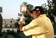 Angel Cabrera of Argentina holds up the Championship trophy for the crowd after winning the 2007 U.S. Open at Oakmont Country Club in Oakmont, Pennsylvania, USA 17 June 2007. Angel Cabrera of Argentina won the Championship with a final score of 285 for a one-stroke victory over Tiger Woods and Jim Furyk of the US.  EPA/ANDREW GOMBERT