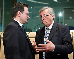 George Papaconstantinou, Greece's finance minister, left, speaks with Jean-Claude Juncker, Luxembourg's prime minister, and president of the Eurogroup, during an emergency meeting of euro zone finance ministers in Brussels, on Sunday, May 2, 2010. Greece accepted an unprecedented bailout from the European Union and International Monetary Fund worth more than 110 billion euros ($146 billion). (Photo © Jock Fistick)