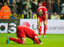 SWANSEA, WALES - Monday, September 16, 2013: Liverpool's Jordan Henderson looks dejected after missing a chance in injury time during the Premiership match against Swansea City at the Liberty Stadium. (Pic by David Rawcliffe/Propaganda)