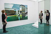 A retrospective of Pop-art pioneer Richard Hamilton opens at the Tate this week. He was widely regarded as the founding figure of Pop art, and this exhibition presents over 60 years of work from 1950s installations to his final paintings of 2011. Major works include: Fun House – An immersive Pop installation featuring a jukebox and blown-up images from Hollywood movies, science-fiction and advertising;  Swingeing London – An iconic image of Mick Jagger following his arrest on drugs charges in 1967; Lobby  (pictured); and his final work – A triptych of computer-aided images printed onto canvas, inspired by the Italian Renaissance masters. Tate Modern, London, UK 11 Feb 2014.