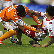 Corey Ashe, (left), Houston Dynamo, clashes with Tim Cahill, New York Red Bulls, during the New York Red Bulls V Houston Dynamo , Major League Soccer second leg of the Eastern Conference Semifinals match at Red Bull Arena, Harrison, New Jersey. USA. 6th November 2013. Photo Tim Clayton