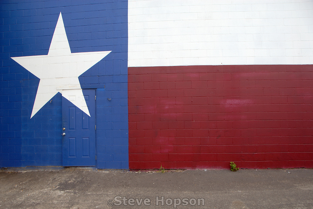 A Texas flag mural painted on a cinder block wall in Austin Texas, April 30 2008.