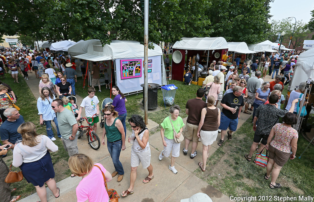 People look at items for sale at various booths during the 20th Annual Marion Arts Festival at City Square Park in Marion on Saturday, May 19, 2012. (Stephen Mally/Freelance)