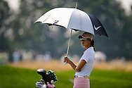 Michelle Wie waits to play a shot during the first round of the Women's U.S. Open Golf Championship in Oakmont, Pennsylvania.