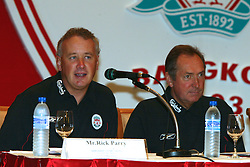 BANGKOK, THAILAND - Thursday, July 22, 2003: Liverpool's manager Gerard Houllier (r) and Chief-Executive Rick Parry at a press conference at the Merchant Court Hotel in Bangkok, ahead of their preseason match against Thailand. (Pic by David Rawcliffe/Propaganda)