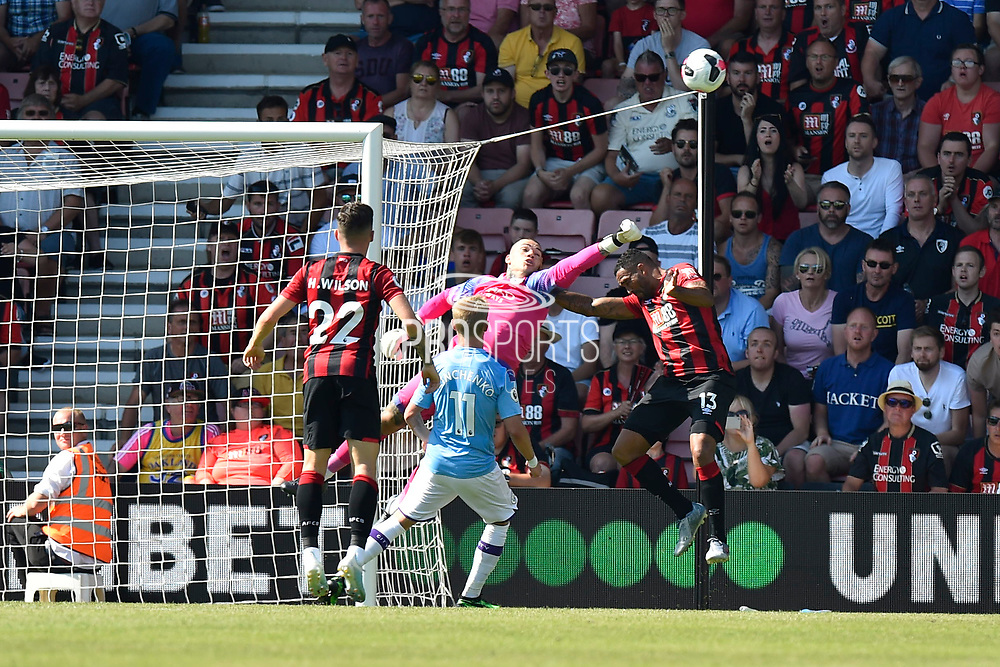Ederson Moraes (31) of Manchester City punches the ball away from Callum Wilson (13) of AFC Bournemouth during the Premier League match between Bournemouth and Manchester City at the Vitality Stadium, Bournemouth, England on 25 August 2019.