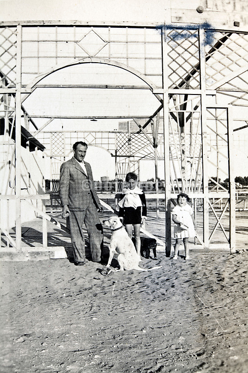 posing by a decorative house frame under construction Morocco 1930s