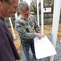 Adam Robison | BUY AT PHOTOS.DJOURNAL.COM<br /> Charlie Usery, owner of Newcreation LLC, in Farmington Missouri, goes over the blueprint, with worker Donnie Morris, of the new playground equipment being installed at Chandler Park in Tupelo.