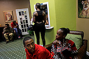 Kimberly Daniels, a.k.a. Kim Cartelle, center, a female rapper in Fort Myers, and others wait for the start of the Ford Entertainment Awards Show at Alliance for the Arts in Fort Myers. The show was an attempt to bring unity within the hip hop community in Fort Myers and recognize the work of local artists.
