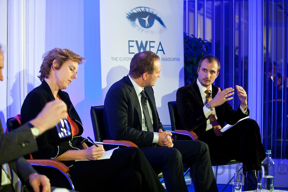 From left: Connie Hedegaard, European Commissioner for Climate Action, Martin Lidegaard, Minister for Climate, Energy and Building, Denmark, and Josche Muth, Acting Secretary General, EREC - European Renewable Energy Council, speaking at the EWEA Debate meeting on Achieving 30% lower emissions in the EU: the role of wind energy & other renewables at the EWEA office in Brussels 8 November 2011. Photo: Erik Luntang/INSPIRIT