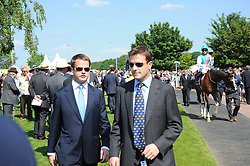 JP MAGNIER & TOM MAGNIER at the Investec Ladies Day at Epsom Racecourse, Surrey on 4th June 2010.