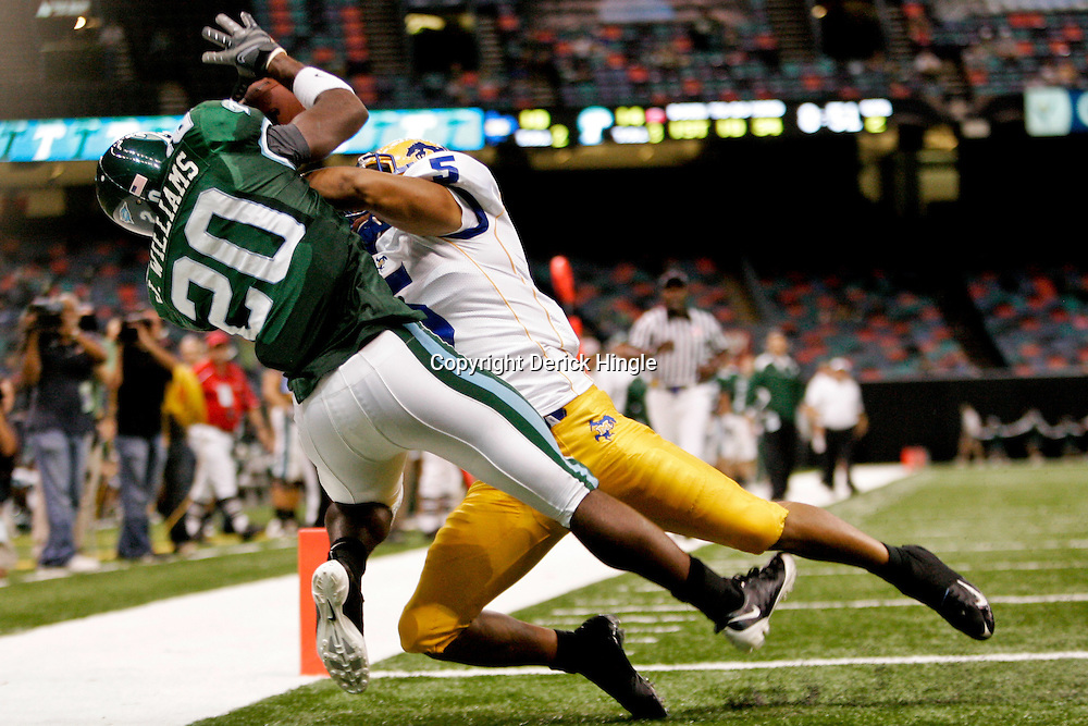 Sep 26, 2009; New Orleans, LA, USA;  Tulane Green Wave wide receiver Jeremy Williams (20) catches a touchdown over McNesse State Cowboys cornerback London Durham (5) at the Louisiana Superdome. Tulane defeated McNeese State 42-32. Mandatory Credit: Derick E. Hingle-US PRESSWIRE