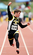 Andale's Ethan Ungles celebrates after winning the 4A boys 100 meters at the state track meet Saturday in Wichita. (Travis Morisse)