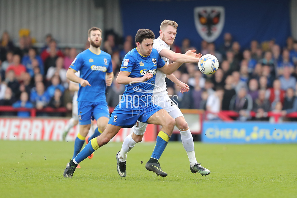 AFC Wimbledon defender Will Nightingale (5) and Northampton Town striker Michael Smith (24) during the EFL Sky Bet League 1 match between AFC Wimbledon and Northampton Town at the Cherry Red Records Stadium, Kingston, England on 11 March 2017. Photo by Stuart Butcher.
