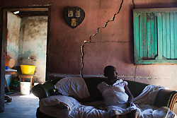 Victoria Fernandez Chavez, 72, sits in her home on January 13, 2013 in Sambo Creek, Honduras. Victoria was diagnosed with HIV in 2006 and currently lives alone in her home. According to the Centers for Disease Control, 4.5% of the Garifuna population has HIV.(David Rochkind/ Pulitzer Center)