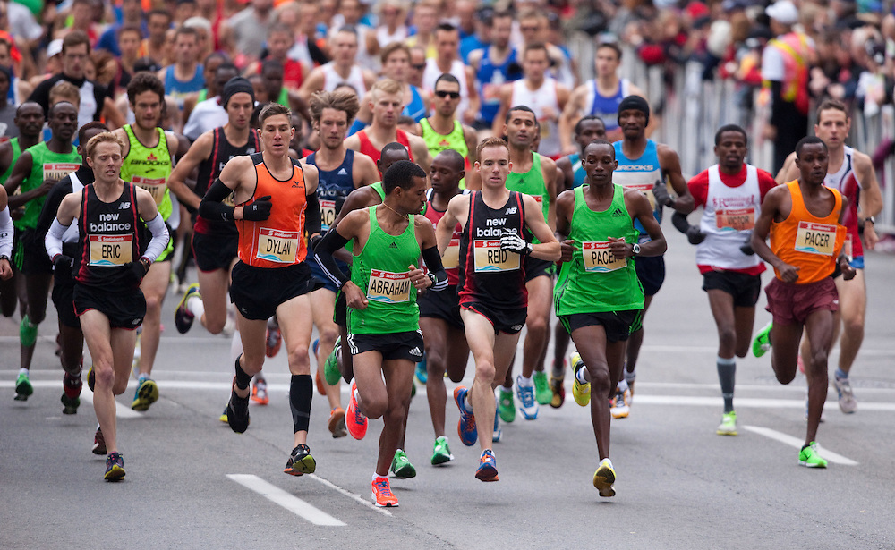 Toronto, Ontario ---11-10-16--- Reid Coolsaet gets out with the leaders at the start of the Scotiabank Toronto Waterfront Marathon, October 16, 2011.<br /> GEOFF ROBINS Mundo Sport Images
