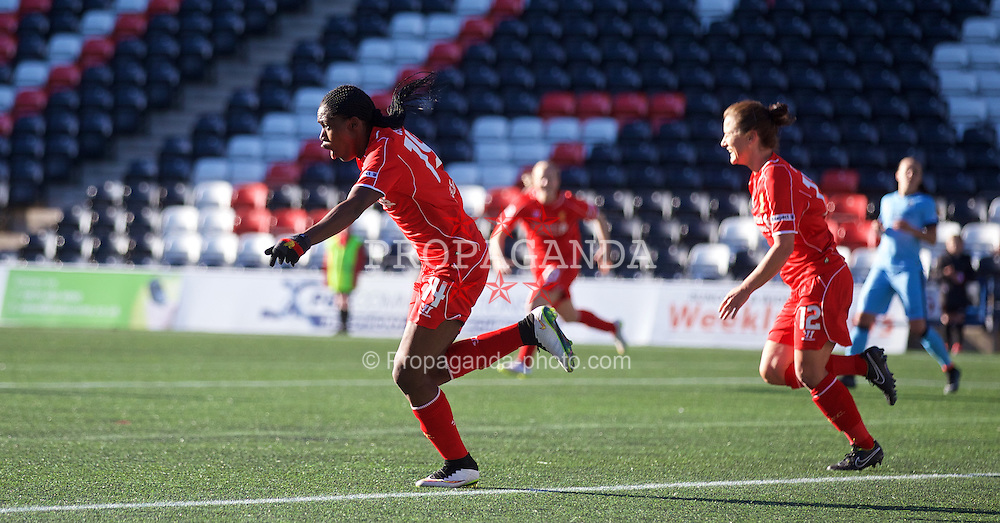 WIDNES, ENGLAND - Sunday, April 26, 2015: Liverpool Ladies' Asisat Oshoala celebrates scoring the first goal against Manchester City during the FA Women's Super League match at the Halton Stadium. (Pic by David Rawcliffe/Propaganda)
