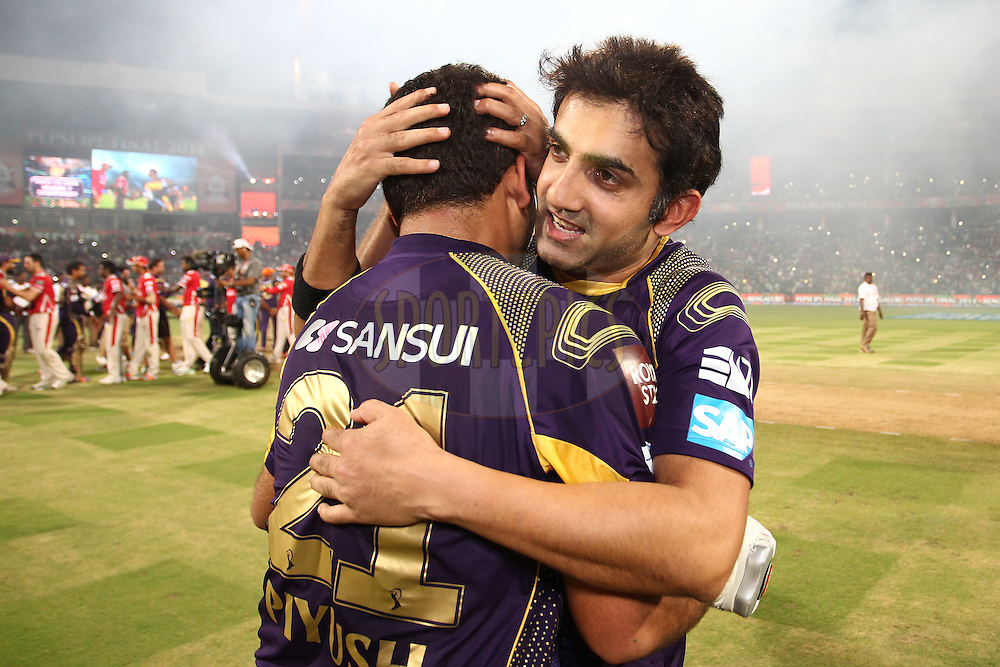 Piyush Chawla of the Kolkata Knight Riders and Gautam Gambhir captain of the Kolkata Knight Riders celebrate as Kolkata Knight Riders are crowd Pepsi IPL Champions during the final match of the Pepsi Indian Premier League Season 2014 between the Kings Xi Punjab and the Kolkata Knight Riders held at the M. Chinnaswamy Stadium, Bangalore, India on the 1st June  2014<br /> <br /> Photo by Shaun Roy / IPL / SPORTZPICS<br /> <br /> <br /> <br /> Image use subject to terms and conditions which can be found here:  http://sportzpics.photoshelter.com/gallery/Pepsi-IPL-Image-terms-and-conditions/G00004VW1IVJ.gB0/C0000TScjhBM6ikg