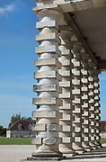 Doric columns with alternating cubic and cylindrical forms on the portico of the Director's House or Maison du Directeur, part of the Royal Saltworks or Saline Royale, begun 1775 in Neoclassical style by architect Claude Nicolas Ledoux, 1736-1806, at Arc-et-Senans, Doubs, Bourgogne-Franche-Comte, France. The Director's House has an imposing portico with 6 columns, a triangular pediment with oculus and a belvedere. It houses an assembly room, offices, bank, apartments, servants quarters and a basement for storage. The site is designed in a semicircle, with the Director's House, 2 saltworks containing drying ovens, heating pots and salt stores, workers' accommodation and Director's stables. An Ideal City was also planned but never built. The site is listed as a UNESCO World Heritage site. Picture by Manuel Cohen
