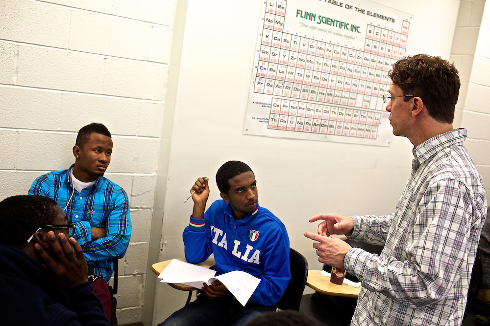 Greg Wahl, right, associate professor at Montgomery College, answers questions from students in his Basic Writing II class, including Elhadj Diebate, left, and Samuel Hadgu, center, before students formed groups to begin work on their final project for class. If students pass this class, it allows them to progress to the college level english program. Otherwise students will face the decision to take the remedial class again or drop out.
