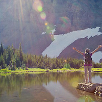 woman hiker alpine lake preston park glacier national park montana