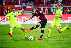 12.08.2016, Grundig Stadion, Nuernberg, GBR, 2. FBL, 1. FC Nuernberg vs 1. FC Heidenheim, 2. Runde, im Bild Kevin Kraus (1. FC Heidenheim / links) wirft sich in einen Schuss von Guido Burgstaller (1. FC Nuernberg / Mitte). Rechts im Bild: Sebastian Griesbeck (1. FC Heidenheim) // during the 2nd German Bundesliga 2nd round match between 1. FC Nuernberg and 1. FC Heidenheim at the Grundig Stadion in Nuernberg, Germany on 2016/08/12. EXPA Pictures © 2016, PhotoCredit: EXPA/ Eibner-Pressefoto/ Merz<br /> <br /> *****ATTENTION - OUT of GER*****