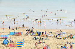 Holidaymakers on the beach at Vking Bay in Broadstairs, Kent.