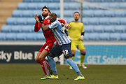 Coventry City forward Marc-Antoine Fortune (32)  battles with Swindon Town defender,on loan from Southampton, Jordan Turnbull (6)  during the Sky Bet League 1 match between Coventry City and Swindon Town at the Ricoh Arena, Coventry, England on 19 March 2016. Photo by Simon Davies.