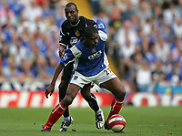 Photo: Lee Earle.<br /> Portsmouth v Wigan Athletic. The Barclays Premiership. 09/09/2006. Wigan's Emerson Boyce (L) battles with Kanu.